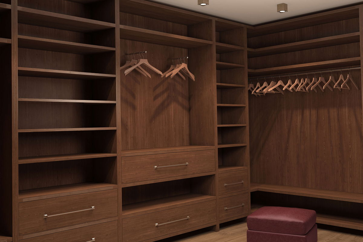 custom closet made out of wood cabinets