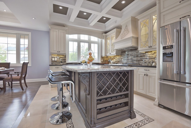Classic Kitchen, made with dark brown island and grey granite countertop. Has a built in wine holder in island with metal bar stools. Pot lights in ceiling.