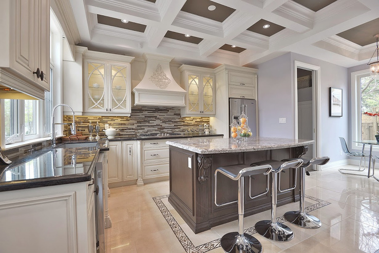 Classic Kitchen made for Nini. Made with White Slate cabinets. Dark brown island with light grey granite and bar stools. Includes a grey backslash.