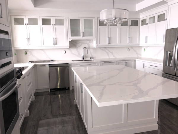 White marble kitchen with dark tiles after Kitchen Renovations completed
